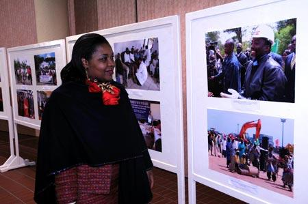 A woman visits the photo exhibition about the achievements of the follow-up actions of the Beijing Summit of the Forum on China-Africa Cooperation (FOCAC), in Tunis, capital of Tunisia, on Nov. 9, 2009. The week-long photo exhibition, held by the Chinese Embassy to Tunisia, started in Tunis on Nov. 9. (Xinhua/Liu Shun)