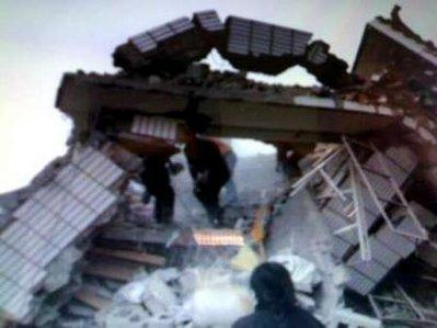 A photo taken by a mobile phone shows destroyed houses after an earthquake hit the Tibetan Autonomous Prefecture of Yushu, northwest Qinghai province in China April 14, 2010