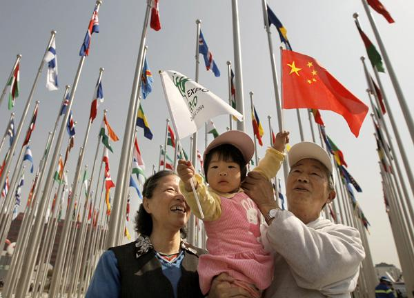 A little girl and her grandparents visit the flags square at the World Expo Park in Shanghai, east China, April 30, 2010. The opening ceremony of the World Expo will be held in Shanghai on Friday night. (Xinhua/Wang Song)