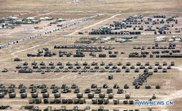 Photo taken on Sept. 16, 2010 from a Chinese military helicopter shows the aerial view of tanks and armored vehicles in a camp of troops attending