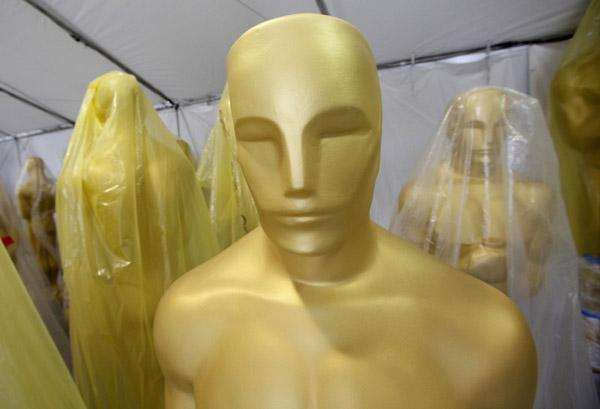 Oscar statues are seen stored in a tent during preparations for the 83rd annual Academy Awards in Hollywood, February 23, 2011. The Oscars will be presented this Sunday.