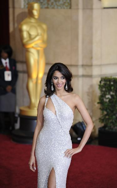 Mallika Sherawat arrives for the awarding ceremony of the 83rd Annual Academy Awards at the Kodak Theater in Hollywood, California, the United States, Feb. 27, 2011. (Xinhua/Qi Heng)