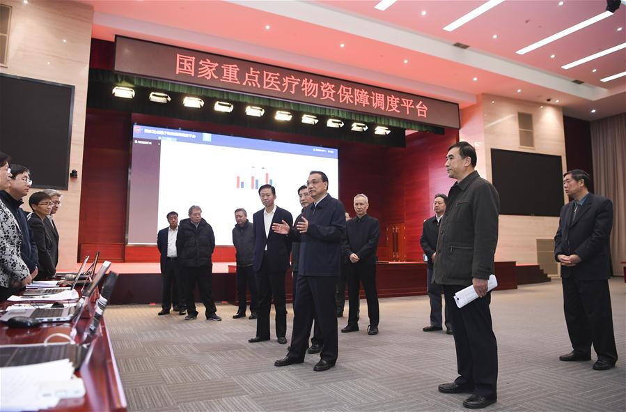 Chinese Premier Li Keqiang, also a member of the Standing Committee of the Political Bureau of the Communist Party of China (CPC) Central Committee and head of the leading group of the CPC Central Committee on the prevention and control of the novel coronavirus outbreak, inspects a national coordination center of key medical supplies for epidemic prevention and control in Beijing, capital of China, Feb. 1, 2020. (Xinhua/Zhang Ling)