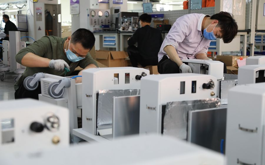Employees assemble ventilators at a plant of Beijing Aeonmed Co., LTD., an anesthesia and respiratory medical equipment enterprise, in Yanjiao, a town of north China