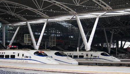 High-speed trains wait for departure at Guangzhou south railway station in Guangzhou, capital of south China's Guangdong Province, on Jan. 30, 2010. The Asia's biggest railway station came into use on Saturday, the first day of Chinese spring festival transport rush of 2010. (Xinhua File Photo)