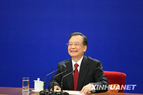 Chinese Premier Wen Jiabao smiles during a press conference after the closing meeting of the Third Session of the 11th National People's Congress (NPC) at the Great Hall of the People in Beijing, capital of China, March 14, 2010. (Xinhua/Xing Guangli)