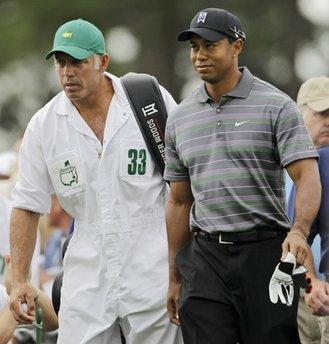 Tiger Woods makes his way to the first tee with caddie Steve Williams during the first round of the Masters golf tournament in Augusta, Ga. on Apirl 8, 2010. [Agencies]