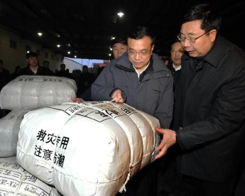 Chinese Vice Premier Li Keqiang (L, front) inspects the the urgent transportation of quake relief supplies in Shenyang, capital of northeast China's Liaoning Province, April 15, 2010. Li Keqiang on Thursday called for full commitment in the logistics work for the earthquake relief to ensure the basic livelihood of the people in quake-hit areas. (Xinhua/Li Tao)
