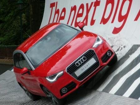 A citizen drives Audi A1 during a presentation publicizing new Audi A1 cars in Brussels, capital of Belgium, May 13, 2010. Audi A1 was officially put into production in Audi's Brussels assembly on Tuesday. (Xinhua/Wang Xiaojun)
