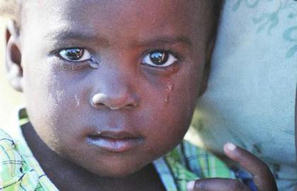 "Tear stains are seen on the face of a child at the orphanage ""solidarity and fraternity"" in Port-au-Princes, capital of Haiti, Jan. 30, 2010. (Xinhua File Photo)"
