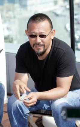 "Chinese actor and director Jiang Wen is interviewed on the sidelines of the 63rd Cannes Film Festival in Cannes, France, on May 19, 2010. Jiang's newly-directed film ""Let The Bullets Fly"" has premiered its first trailer at the Cannes Film Festival on May 18. (Xinhua/Xiao He)"