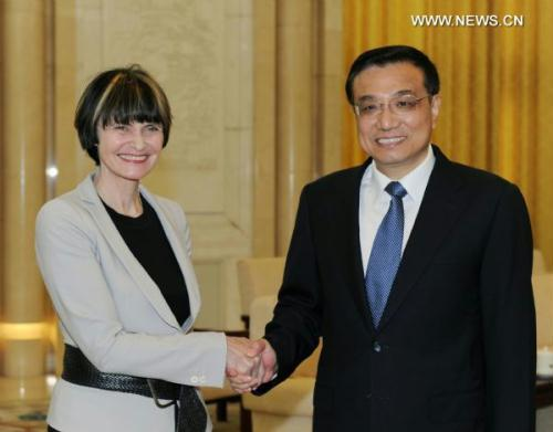 Chinese Vice Premier Li Keqiang (R) shakes hands with Swiss Foreign Minister Micheline Calmy-Rey during their meeting in Beijing, capital of China, on June 28, 2010. (Xinhua/Rao Aimin)