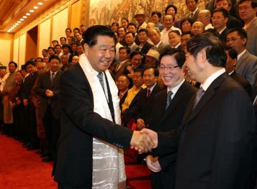 Jia Qinglin (L, front), a member of the Standing Committee of the Political Bureau of the Communist Party of China (CPC) Central Committee, also chairman of the National Committee of the Chinese People's Political Consultative Conference (CPPCC), meets with representatives of the second congress of the China Association for the Preservation and Development of Tibetan Culture, at the Great Hall of the People in Beijing, capital of China, on June 30, 2010.(Xinhua/Liu Weibing)
