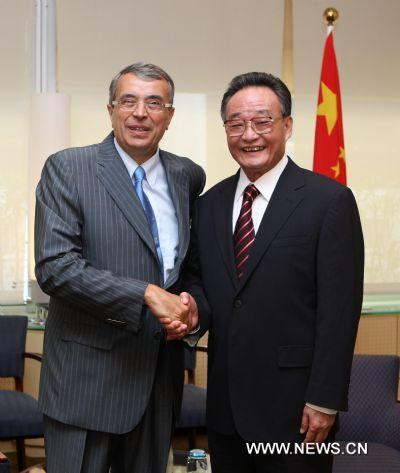 Wu Bangguo (R), chairman of the Standing Committee of China's National People's Congress, the country's top legislature, meets with Jean-Jack Queyranne, president of the Rhone-Alpes Regional Council, in Lyon, France, July 11, 2010.(Xinhua/Ju Peng)