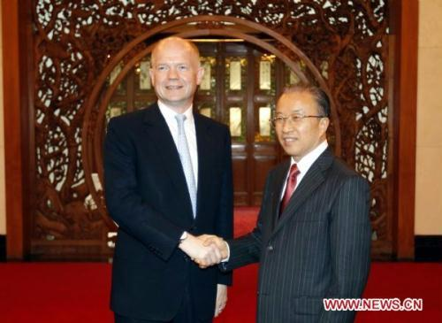 Chinese State Councilor Dai Bingguo (R) shakes hands with British Foreign Secretary William Hague during the first Sino-British high level strategic dialogue held in Beijing, capital of China, July 14, 2010.(Xinhua/Ding Lin)