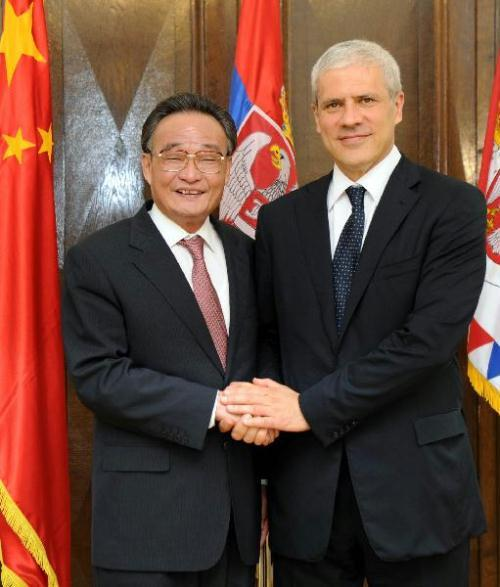 Wu Bangguo (L), chairman of the Standing Committee of China'a National People's Congress(NPC), shakes hands with Serbian President Boris Tadic, in Belgrade, capital of Serbia, July 14, 2010.(Xinhua/Ju Peng)