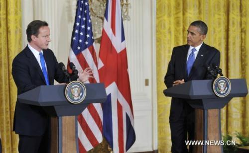U.S.PresidentBarackObama(R)andvisitingBritishPrimeMinisterDavidCameronattendajointpressconferenceaftertheirmeetingattheEastRoomoftheWhiteHouseinWashingtonD.C.,capitaloftheUnitedStates,July20,2010.(Xinhua/ZhangJun)