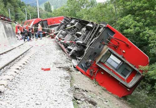 A derailed carriage of the Glacier Express tourist train lies on its side near Fiesch in the southern part of Switzerland in this July 23, 2010 police handout picture. (Xinhua/Reuters)