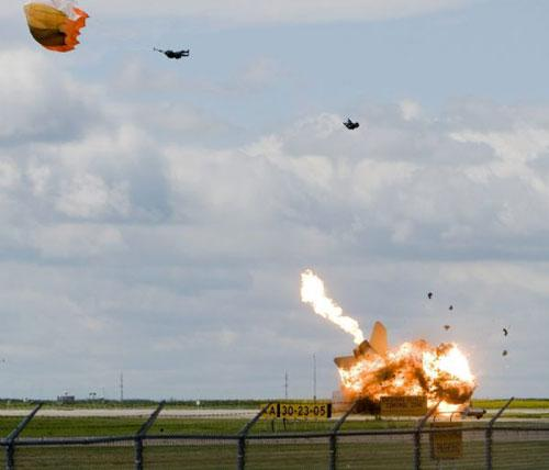 Pilot Capt. Brian Bews parachutes to safety as his a CF-18 fighter jet crashes and explodes during a practice flight at the Lethbridge County Airport on Friday, July 23, 2010 for the weekend airshow in Lethbridge, Alberta, Canada. (Xinhua/AP)