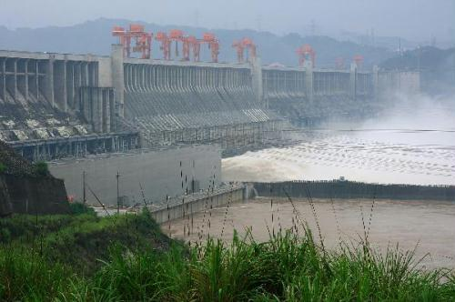 Flood waters are sluiced with the water outflux monitored at 40,000 cubic meters per second at Three Gorges Dam in Yichang, central China's Hubei Province, July 20, 2010. (Xinhua/Xia Lin)