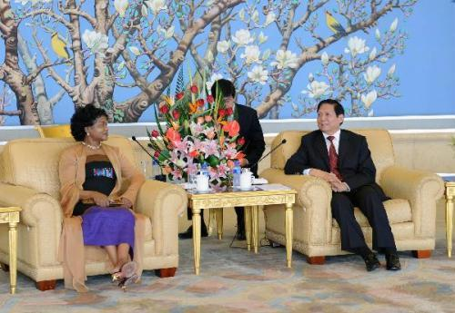 Liu Qi(R1), a member of the Political Bureau of the Central Committee of the Communist Party of China (CPC) and secretary of the CPC Beijing Municipal Committee, meets with chairperson of South Africa's African National Congress (ANC) Baleka Mbete in Beijing, capital of China, July 28, 2010. (Xinhua/Li Tao)