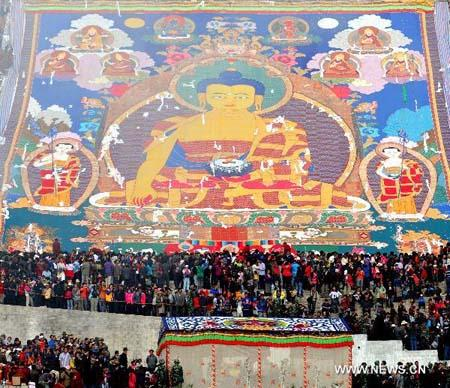 Buddha Thangka painting unfolding ceremony is held in Zhaibung Monastery on the outskirts of Lhasa, capital of southwest China's Tibet Autonomous Region, on Aug. 10, 2010. The annual traditional Shoton (Yogurt) Festival, inscribed on the list of China Intangible Cultural Heritage in May 2006, was opened here on Tuesday. Buddha Thangka painting unfolding ceremonies in Zhaibung Monastery and Sera Monastery, Tibetan operas, and horse racing are to be presented during the Shoton Festival. Shoton, or Xodoin, means yogurt banquet in the Tibetan language, and the Shoton Festival, believed to originate in the 11th century and been originally a religious activity for pilgrims to serve yogurt to monks and nuns who finished their summer retreat, had gradually become a theatrical event by mid-17th century. (Xinhua photo)