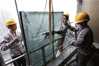 Workers prepare to rebuild the hotel adjacent to the new CCTV headquarters. [Photo: Beijing Urban Construction Group]
