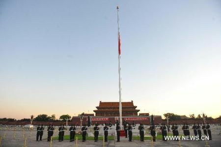 The national flag of China flies at half-mast on Tian'anmen Square in Beijing, capital of China, early Aug. 15, 2010, to mourn for the victims of the mudslide disaster in Zhouqu. National flags across the country and at overseas embassies and consulates are to be lowered to half-mast Sunday to mourn the victims of the devastating mudslide which hit Zhouqu County, Gannan Tibetan Autonomous Prefecture in southern Gansu on Aug. 8, 2010. (Xinhua/Luo Xiaoguang)