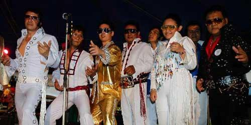 Contestants dressed as Elvis Presley pose before a sing-a-like contest in a mall in Manila August 15, 2010. At least 22 avid fans dressed as Elvis Presley took part in the contest on Sunday in tribute for his 33rd death anniversary on Monday. Presley died in Graceland on August. 16, 1977. (Xinhua/Reuters Photo)