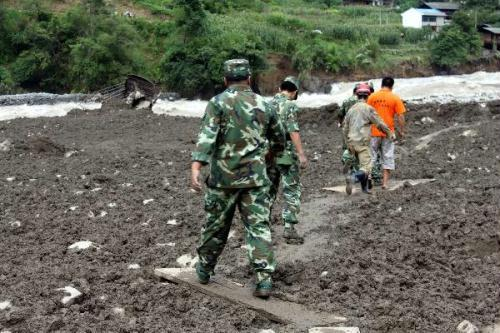 At least 67 people are missing and seven others injured after mudslides slam a remote town in southwest China's Yunnan Province early Wednesday. (Xinhua photo)