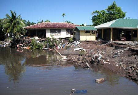The damaged building of the Development Bank of American Samoa is seen after a tsunami hit Pago-Pago, the capital of American Samoa September 29, 2009. A series of tsunamis smashed into the Pacific island nations of American and Western Samoa killing possibly more than 100 people, some washed out to sea, destroying villages and injuring hundreds, officials said on Wednesday. A Pacific-wide tsunami warning was issued after an 8.0 magnitude undersea quake off American Samoa, with small tsunamis reaching New Zealand, Hawaii and Japan.   (Xinhua/Reuters File Photo)