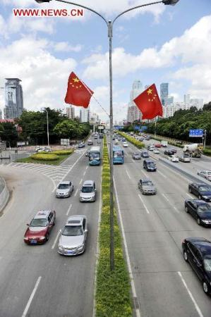 National flags are seen on Binhe avenue in Shenzhen, south China's Guangdong Province, Aug. 23, 2010. The year 2010 marks the 30th anniversary of the founding of Shenzhen Special Economic Zone. (Xinhua/Chen Yehua)