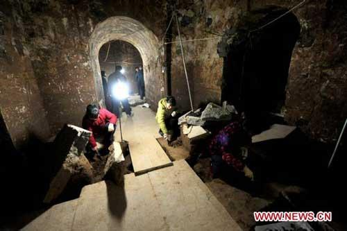 The file picture taken on Dec. 30, 2009 shows archaeologists clean up the archaeological site where the Mausoleum of Cao Cao is located in Anyang, a city in central China's Henan Province. The Mausoleum of Cao Cao, a legendary Chinese warlord during the Three Kingdoms period (208-280 A.D.), has recently been declared as Cultural Relics under Provincial Protection. The tomb is located near the Yellow River and the city of Anyang, where Cao Cao ruled the Kingdom of Wei from 208 to 220, when he died at the age of 65. (Xinhua/Zhu Xiang)