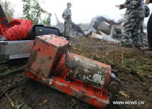 The black-box of a crashed passenger plane is found in Yichun City, northeast China's Heilongjiang Province, Aug. 25, 2010. A passenger plane with 96 people on board crashed late Tuesday night near the Yichun airport. At least 42 people were confirmed dead while the remaining 54 have been rescued and sent to hospitals.(Xinhua/Li Yong)