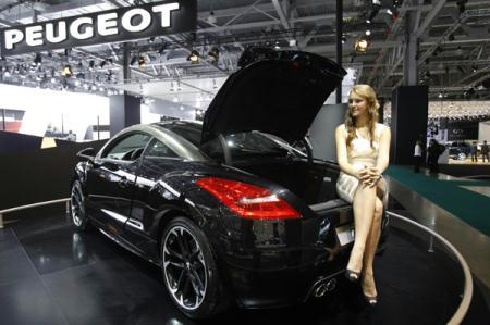 A Peugeot RCZ Black Yearling is seen at the Moscow Auto Salon 2010 (the Moscow International Motor Show), August 25, 2010. Russia's car market is emerging fast from the crisis as cheap loans return and consumer confidence grows, leading auto makers said on Wednesday as they delivered upbeat forecast for sales growth this year.