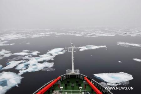 "Photo taken on Aug. 28, 2010 shows China's icebreaker ""Xue Long"", or ""Snow Dragon"", sailing at the edge of a sea-ice field in the Arctic Ocean. Xue Long arrived at 74 degrees of north latitude for a comprehensive oceanographic survey on Sunday. (Xinhua/Zhang Jiansong)"