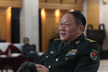 国防部长梁光烈:中国军队现代化要靠我们自力更生