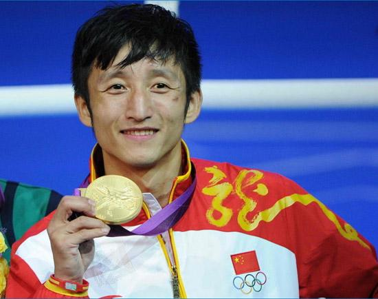 Zou Shiming won his second successive Olympic gold medal on Saturday ...