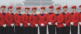 2010年3月3日,全国政协十一届三次会议在北京开幕。两会服务人员在天安门前合影。