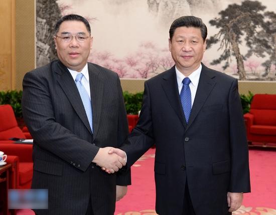 3月18日,中国国家主席习近平在北京中南海会见来京列席第十二届全国人民代表大会第一次会议闭幕式的澳门特别行政区行政长官崔世安。
