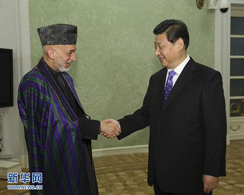 2月7日,国家主席习近平在俄罗斯索契会见阿富汗总统卡尔扎伊。记者 兰红光 摄
