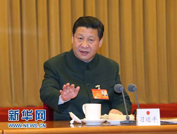 3月11日,中共中央总书记、国家主席、中央军委主席习近平出席十二届全国人大二次会议解放军代表团全体会议并发表重要讲话。新华社记者 李刚 摄