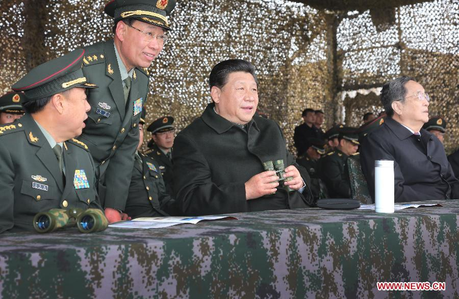 Chinese President Xi Jinping (2nd R) watches drills of troops of the Chinese People