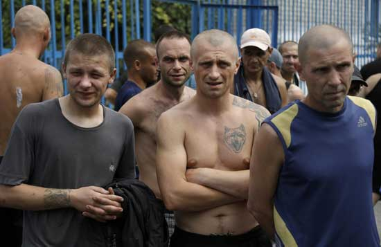 Inmates at a high-security facility stand in a yard after shelling in Donetsk, eastern Ukraine, Monday, Aug. 11, 2014.