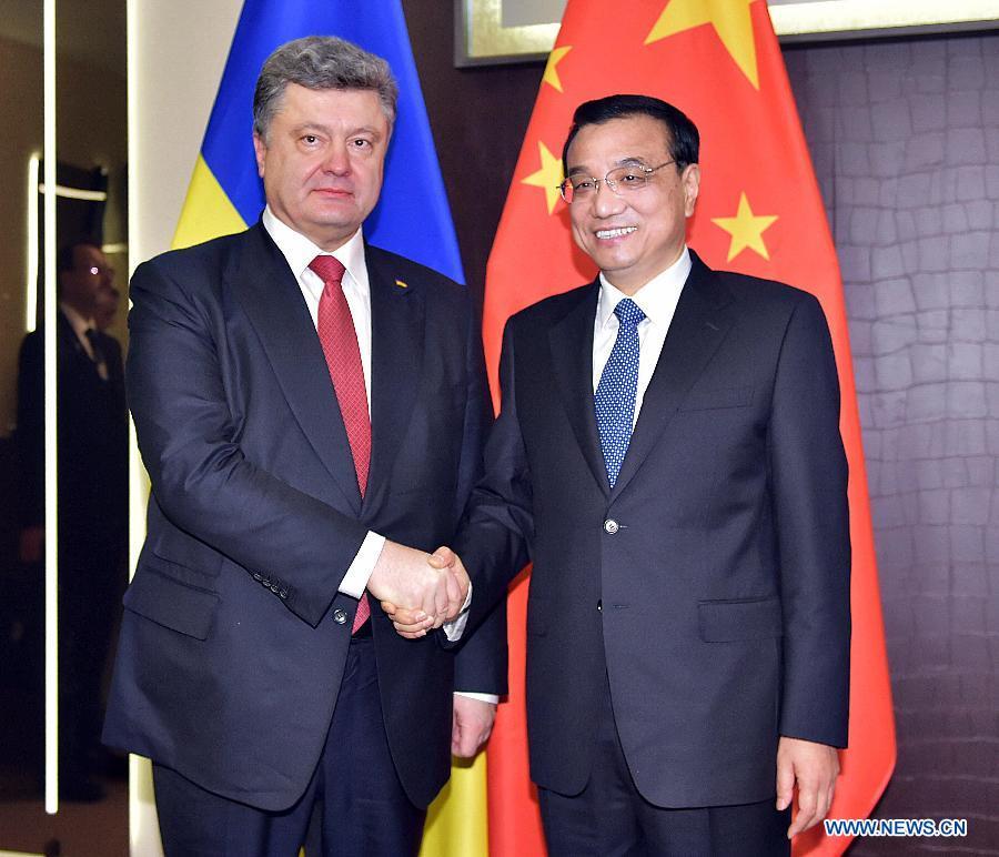 Ли Кэцян встретился с президентом Украины П. Порошенко