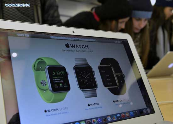 Customers test Apple products at Apple flag store in Manhattan, New York, the United States, on April 9, 2015. Apple Watch, the first Apple product to be worn, will be available for purchase online on April 24, and customers can pre-order from April 10. [Photo: Xinhua/Wang Lei]