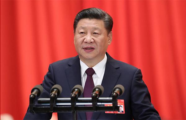 习近平代表第十八届中央委员会向大会作报告。