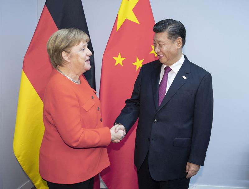 当地时间12月1日,国家主席习近平在布宜诺斯艾利斯会见德国总理默克尔。新华社记者 李涛 摄