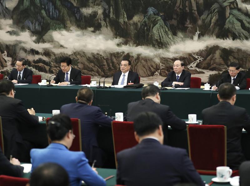 3月8日,中共中央政治局常委、国务院总理李克强参加十三届全国人大二次会议湖北代表团的审议。