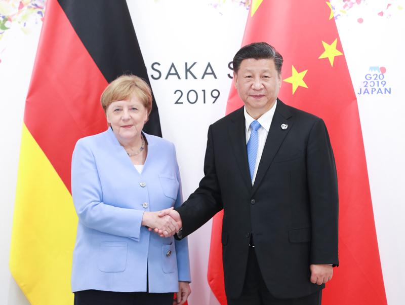 6月28日,国家主席习近平在大阪会见德国总理默克尔。新华社记者 庞兴雷 摄